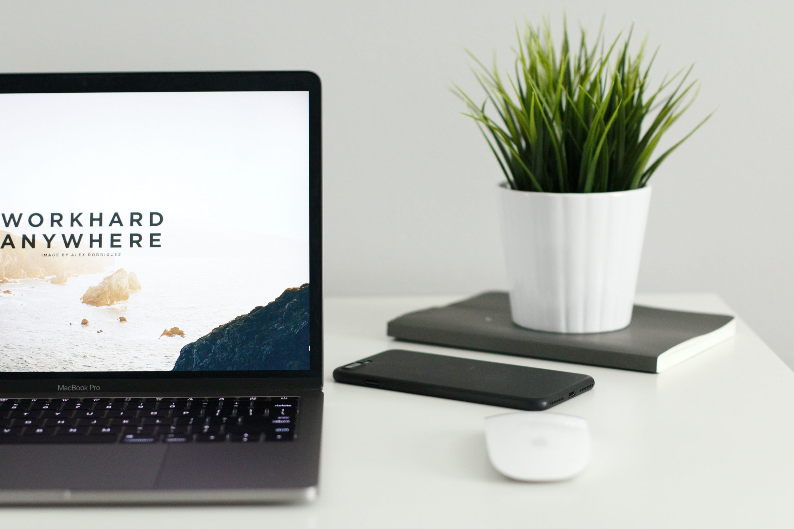Image of computer monitor that says 'Work hard anywhere' on it.